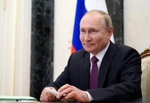FILE PHOTO: Russian President Vladimir Putin takes part in a video conference call with officials and young professionals in Moscow, Russia March 25, 2021.