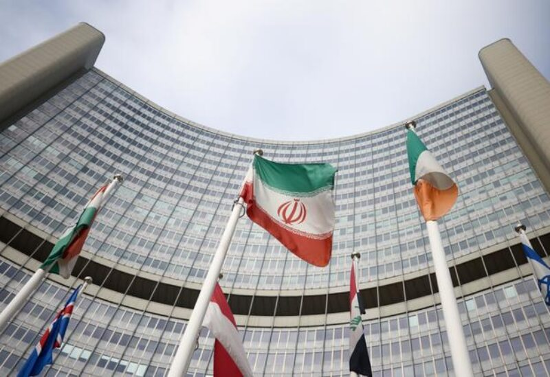 FILE PHOTO: The Iranian flag waves in front of the International Atomic Energy Agency (IAEA) headquarters, amid the coronavirus disease (COVID-19) outbreak in Vienna, Austria, March 1, 2021.