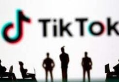 FILE PHOTO: Small toy figures are seen in front of TikTok logo in this illustration picture taken March 15, 2021.