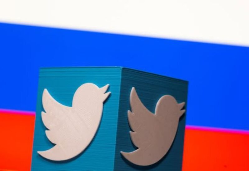 FILE PHOTO: A 3D-printed Twitter logo is pictured in front of a displayed Russian flag in this illustration taken March 10, 2021.