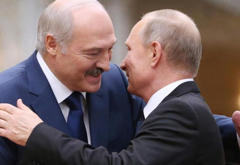 Belarusian President Alexander Lukashenko greets Russian President Vladimir Putin