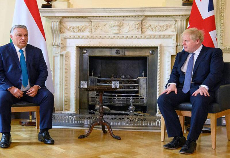 British Prime Minister Boris Johnson talks with Hungarian Prime Minister Viktor Orban