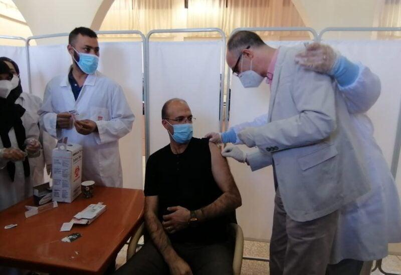 Hamad hassan receiving Astrazanica vaccine