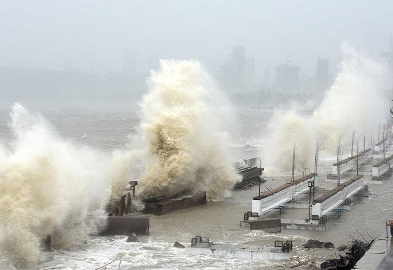 Waves lash over onto a shoreline in Mumbai