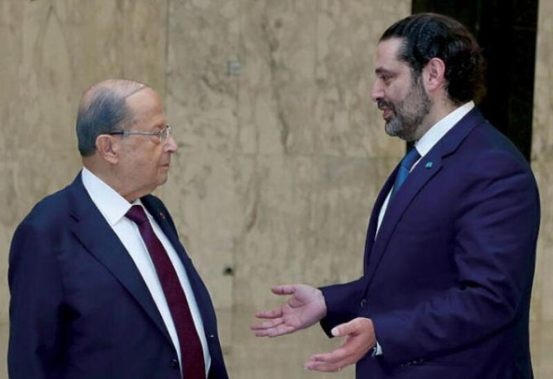 Lebanese President Michel Aoun (left) standing next to Prime Minister-designate Saad al-Hariri (right)