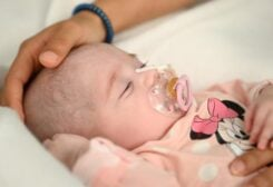 Two-month old Spanish baby girl Naiara, who received a heart transplant in a pioneering surgery where doctors used a heart that had already stopped beating from a donor with a different blood type, is seen in this handout picture released May 17, 2021 by Gregorio Maranon Hospital in Madrid, Spain. REUTERS