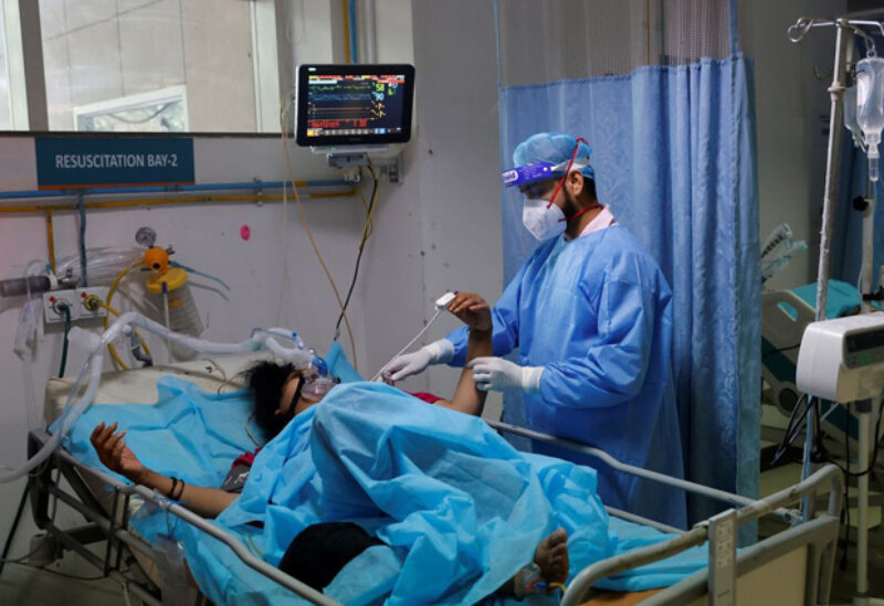 A medical worker tends to a patient suffering from coronavirus disease (COVID-19), as a Syringe Infusion Pump, donated by France is seen next to his bed, inside the emergency room of Safdarjung Hospital in New Delhi, India, May 7, 2021.