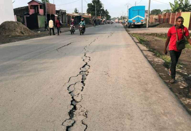 A pedestrian walks near a crack on the road caused by earth tremors as aftershocks following the eruption of Mount Nyiragongo volcano near Goma, in the Democratic Republic of Congo May 26, 2021. REUTERS