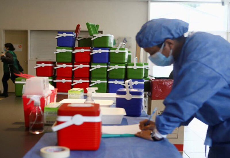 A healthcare worker takes inventory of doses of the Oxford/AstraZeneca coronavirus disease (COVID-19) vaccine