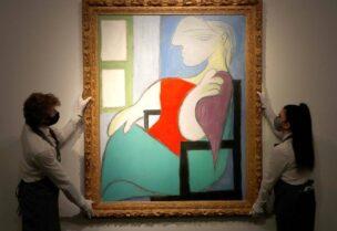 Femme Assise Pres d'Uune Fenetre' by Pablo Picasso