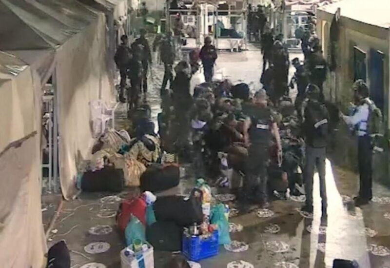 Israeli prison guards assaulting Palestinian inmates
