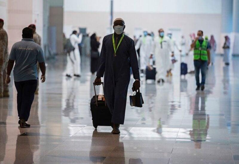 Pilgrims arrive to King Abdulaziz Airport for the Hajj pilgrimage to Mecca, in Jeddah, Saudi Arabia.