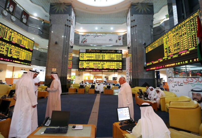 Investors monitor screens displaying stock information at the Abu Dhabi Securities Exchange June 25, 2014. REUTERS/Stringer/File Photo