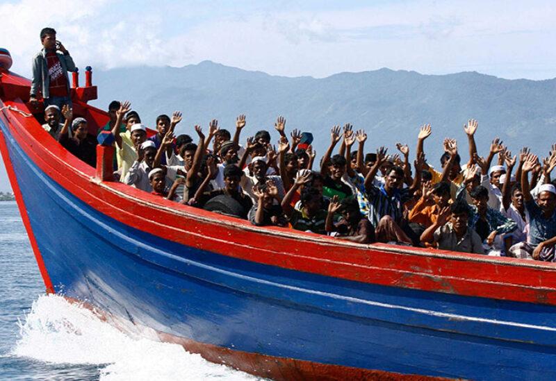 Rohingya refugee fleeing in a boat