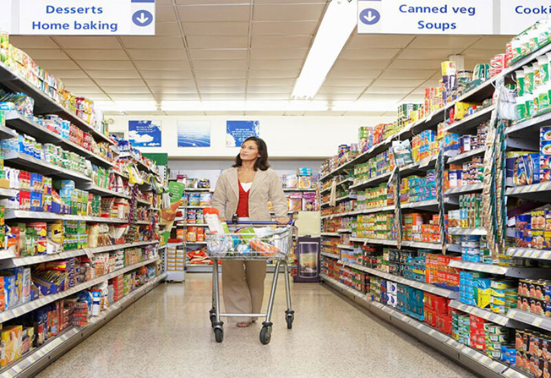 Woman shopping in a supermarket in UK