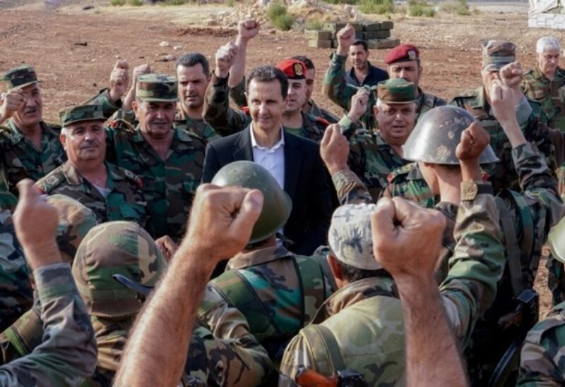 FILE PHOTO: Syrian President Bashar al Assad visits Syrian army troops in war-torn northwestern Idlib province, Syria, in this handout released by SANA on October 22, 2019. REUTERS