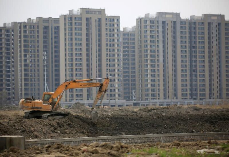 An excavator is seen at a construction site of new residential buildings in Shanghai, China, in this March 21, 2016 file photo. REUTERS