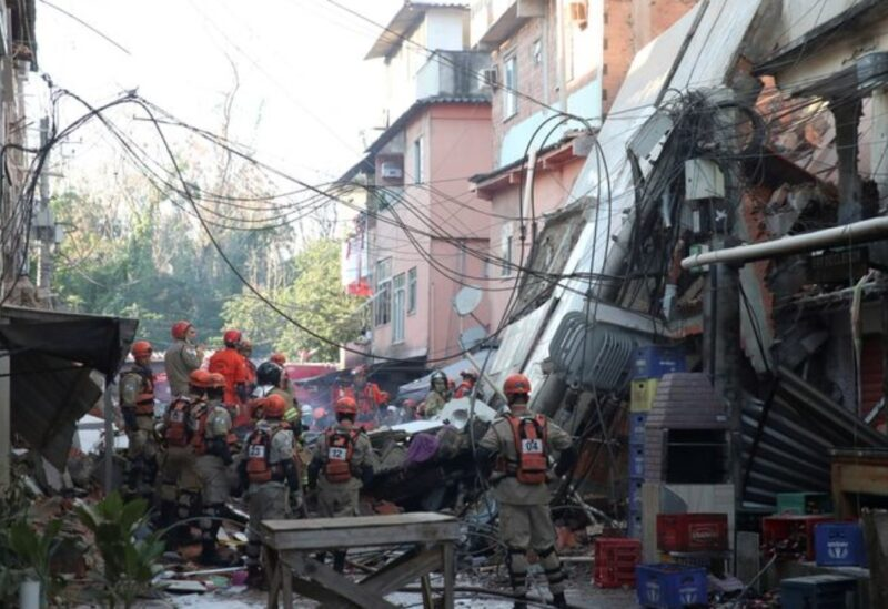 Firefighters search for victims between the debris of a collapsed building in Rio das Pedras slum, Rio de Janeiro, Brazil, June 3, 2021. REUTERS/Ricardo Moraes