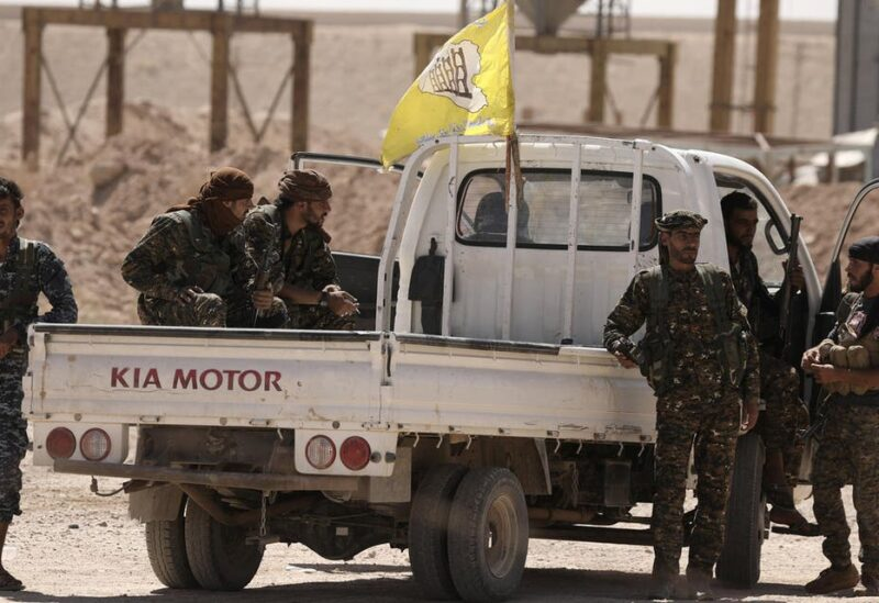 Fighters from Deir al-Zor military council which fights under the Syrian Democratic Forces (SDF) sit on a back of a truck in the village of Abu Fas, Hasaka province, Syria. (File photo: Reuters)