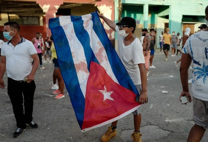 A man waves a Cuban flag during a demonstration against the government of Cuban President Miguel Diaz-Canel in Havana, on July 11, 2021. (Adalberto Roque/AFP)