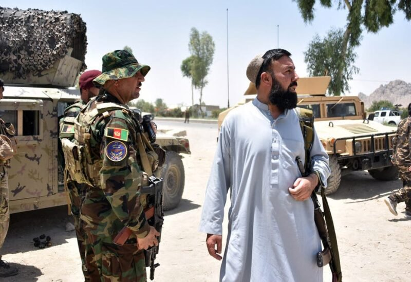 Afghan security personnel stand guard along the road amid ongoing fight between Afghan security forces and Taliban fighters in Kandahar on July 9, 2021. (Stock image)