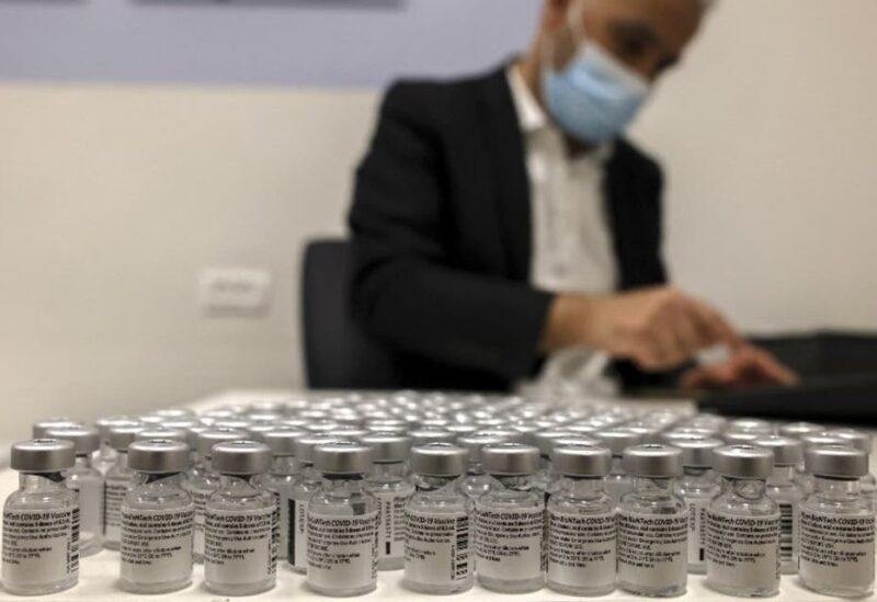 A health worker arranges vials of the Pfizer-BioNtech COVID-19 vaccine at the Clalit Health Services in the Palestinian neighbourhood of Beit Hanina, in the Israeli-annexed East Jerusalem on March 2, 2021. (AFP)