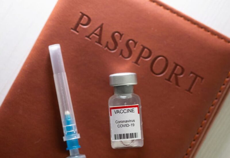 \A syringe and a vial labelled coronavirus disease (COVID-19) vaccine are placed on a passport in this illustration taken April 27, 2021. (File Photo: Reuters)