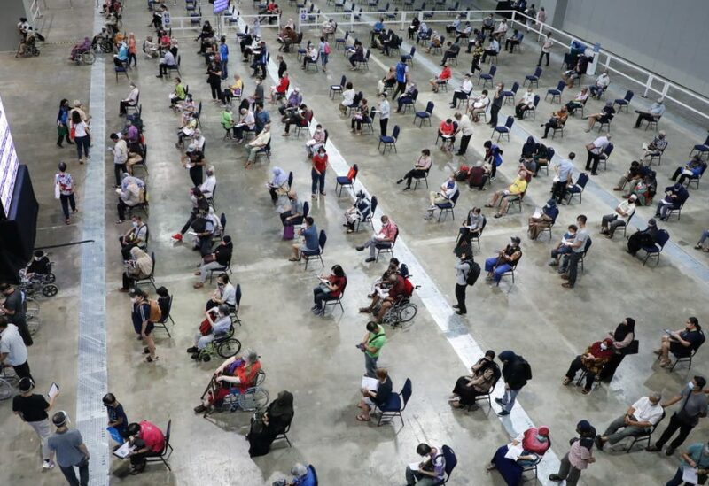 People wait to receive coronavirus disease (COVID-19) vaccines at a vaccination centre in Kuala Lumpur, Malaysia May 31, 2021. (Reuters)