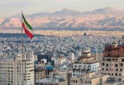 An Iranian flag waves above the Iranian capital Tehran. (iStock)