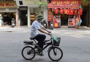 A man rides a bike on an empty street amid the coronavirus (COVID-19) pandemic, in Hanoi, Vietnam, May 31. REUTERS/Thanh Hue