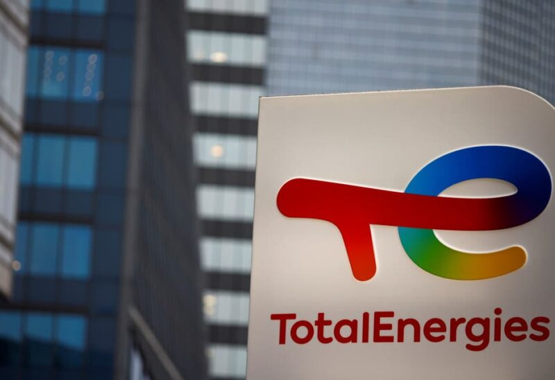 The logo of French oil and gas company TotalEnergies is pictured at an electric car charging station and petrol station at the financial and business district of La Defense in Courbevoie near Paris, France, June 22, 2021. (Reuters)