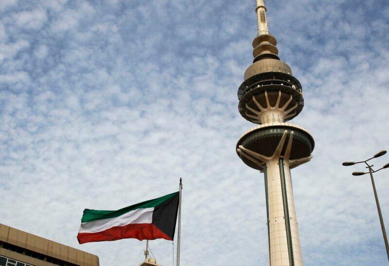 Kuwait's Liberation Tower is seen near a Kuwaiti flag in Kuwait City, Kuwait. (AP)