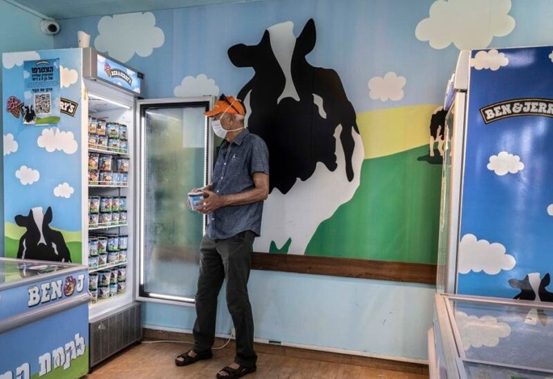 An Israeli shops at the Ben & Jerry's ice-cream factory in the Be'er Tuvia Industrial area, southern Israel. (AP)