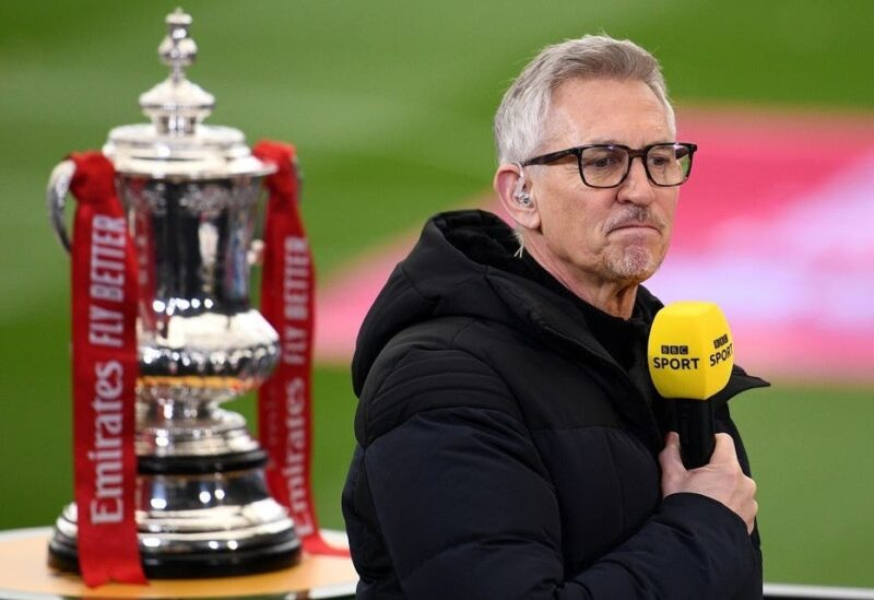 Gary Lineker performing media duties next to the FA Cup trophy before the match in March 2021. (Reuters)