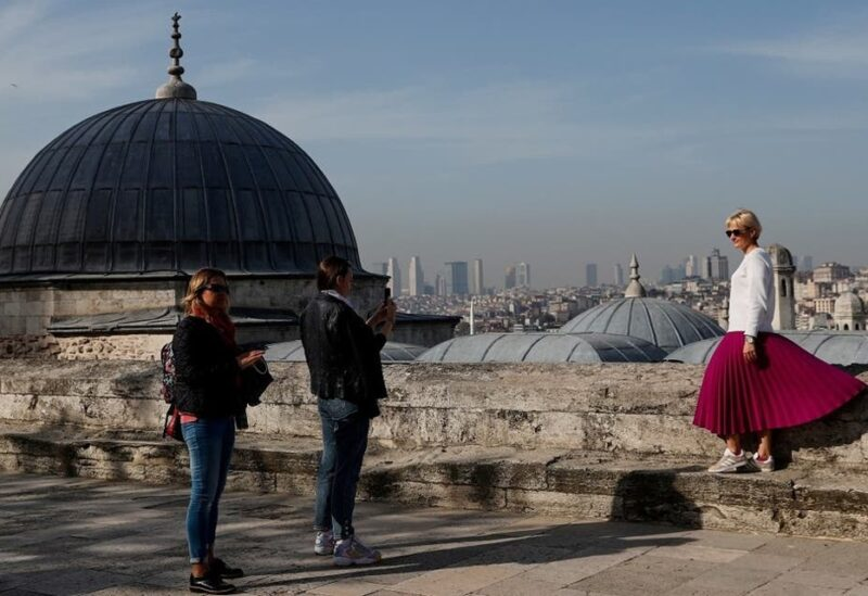 A tourist poses for a souvenir photo outside the historic Suleymaniye Mosque in Istanbul, Turkey, during a nationwide lockdown of the local population imposed to slow the spread of the coronavirus, on April 30, 2021. (File photo: Reuters)