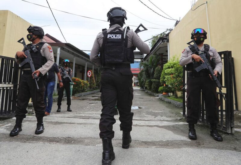 Police officers stand guard at a local police hospital where the bodies of militants killed during a raid were taken to, in Palu, Central Sulawesi, Indonesia, Sunday, July 11, 2021. (AP)