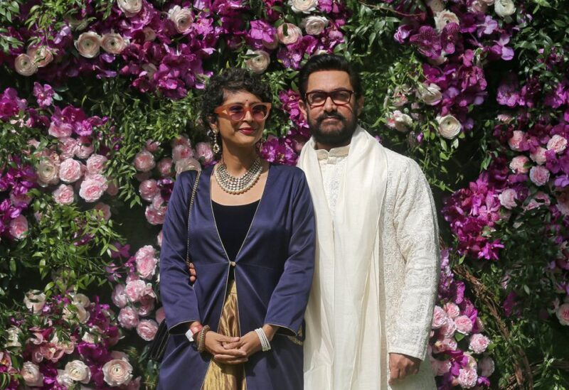 Bollywood actor Aamir Khan and his wife Kiran Rao pose during a photo opportunity at the wedding ceremony of Akash Ambani, son of the Chairman of Reliance Industries Mukesh Ambani, at Bandra-Kurla Complex in Mumbai, India, March 9, 2019. REUTERS/Francis Mascarenhas/File Photo