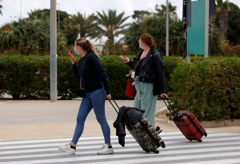 Tourists walk to a taxi stand after arriving in Malta amid the coronavirus disease (COVID-19) pandemic, as Malta officially restarted its tourism season, at Malta International Airport outside Luqa, Malta June 1, 2021. REUTERS/Darrin Zammit Lupi