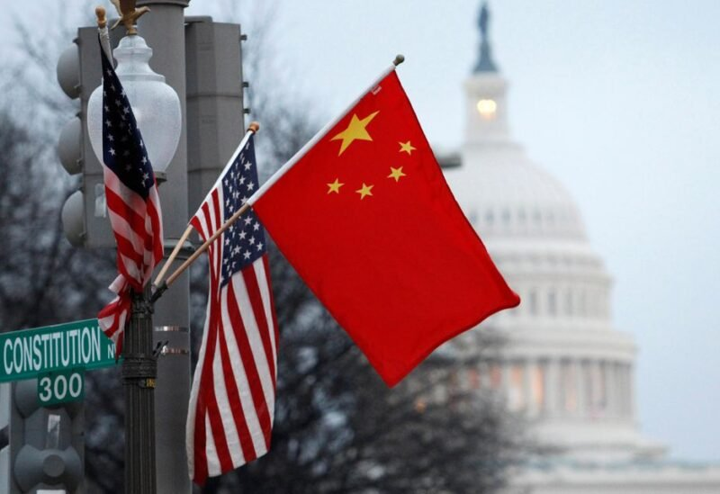 The People's Republic of China flag and the U.S. flag fly on a lamp post along Pennsylvania Avenue near the U.S. Capitol in Washington during then-Chinese President Hu Jintao's state visit, January 18, 2011. REUTERS/Hyungwon Kang/File Photo