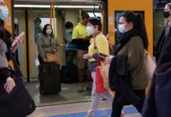 Commuters wear protective face masks on public transit at Central Station following the implementation of new public health regulations from the state of New South Wales, as the city grapples with an outbreak of the coronavirus disease (COVID-19) in Sydney, Australia, June 23, 2021. REUTERS/Loren Elliott