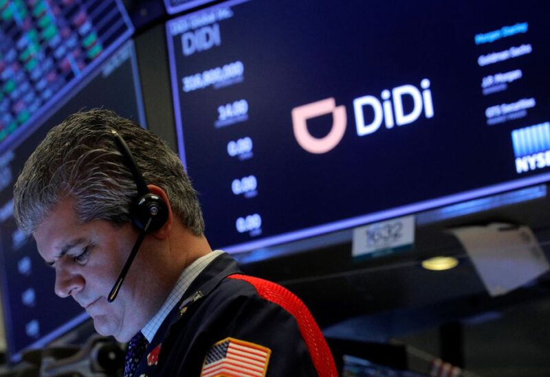 A trader works during the IPO for Chinese ride-hailing company Didi Global Inc on the New York Stock Exchange (NYSE) floor in New York City, U.S., June 30, 2021. REUTERS/Brendan McDermid