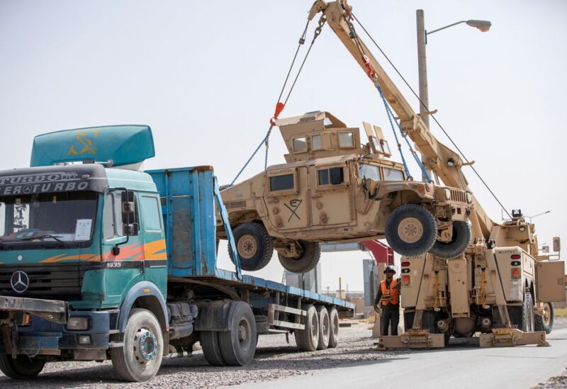 U.S. Army soldiers and contractors load High Mobility Multi-purposed Wheeled Vehicles, HUMVs, to be sent for transport as U.S. forces prepare for withdrawl, in Kandahar, Afghanistan, July 13, 2020. Picture taken July 13, 2020. U.S. Army/Sgt. Jeffery J. Harris/Handout via REUTERS