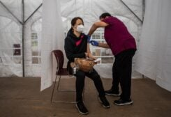 A nurse administers the Moderna Covid-19 vaccine at Kedren Community Health Center, in South Central Los Angeles, California. (AFP)