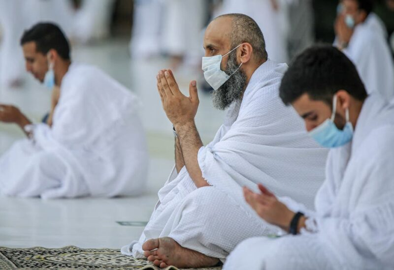 Muslims, keeping a safe social distance, perform Umrah at the Grand Mosque after Saudi authorities ease the coronavirus disease (COVID-19) restrictions, in the holy city of Mecca, Saudi Arabia. (Reuters)