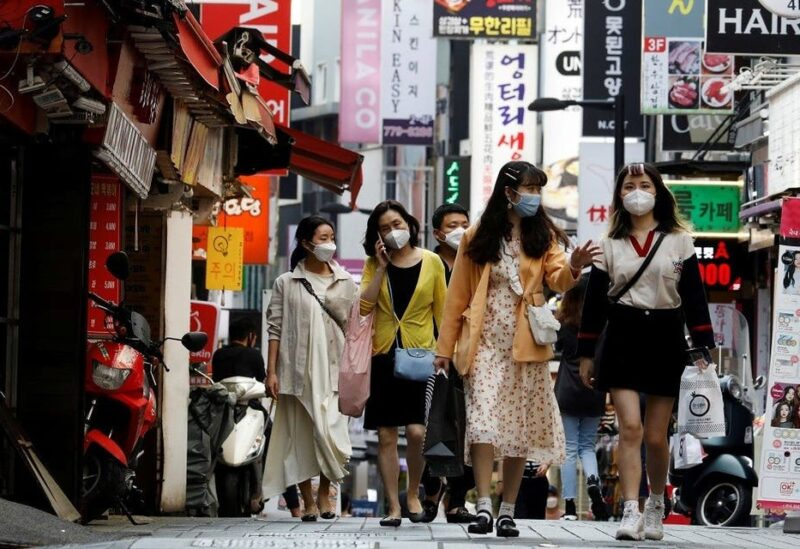 People wearing masks walk at Myeongdong shopping district amid social distancing measures to avoid the spread of the coronavirus disease, in Seoul, South Korea. (File photo: Reuters)