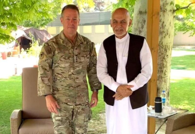 """Afghanistan's President Ashraf Ghani (R) meets General Austin """"Scott"""" Miller, commander of US forces and NATO's Resolute Support Mission in Kabul, Afghanistan, on July 2, 2021. (Reuters)"""