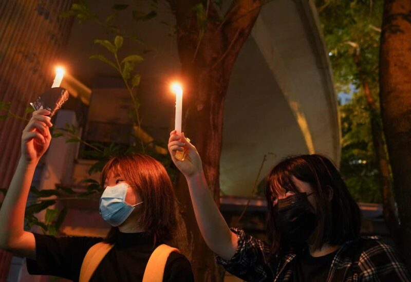 People hold candles at Victoria Park on the 32nd anniversary of the crackdown on pro-democracy demonstrators at Beijing's Tiananmen Square in 1989, in Hong Kong, China, on June 4, 2021. (Reuters)