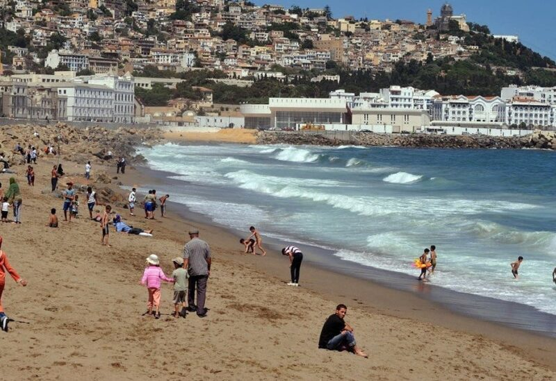 A file photo shows people enjoying Bab El-Ouad beach during a national beaches campaign in Algiers. (Fayez Nureldine/AFP)