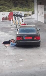 man sleeping on the floor at a gas station