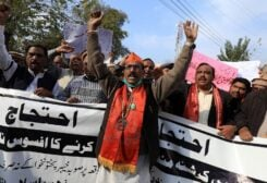 People carry banners as they chant slogans to condemn the attack on a century-old Hindu temple in northwestern Pakistan, during a protest in Peshawar, Pakistan, on January 3, 2021. (Reuters)